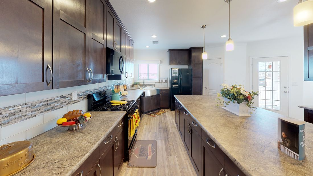 The SUM3068A Kitchen. This Manufactured Mobile Home features 3 bedrooms and 2 baths.