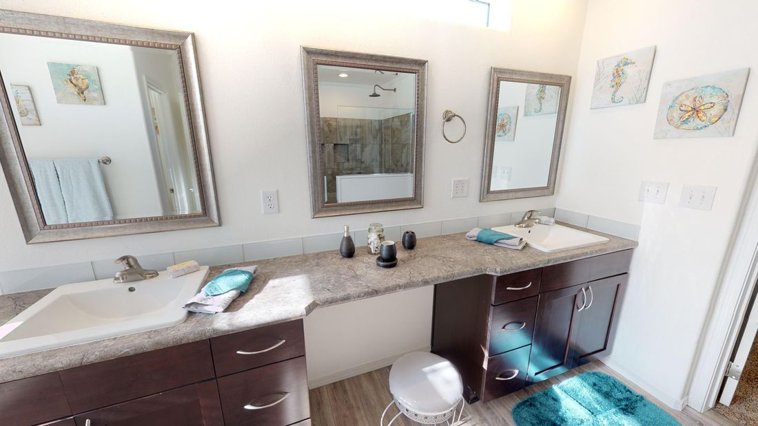 The SUM3068A Master Bathroom. This Manufactured Mobile Home features 3 bedrooms and 2 baths.