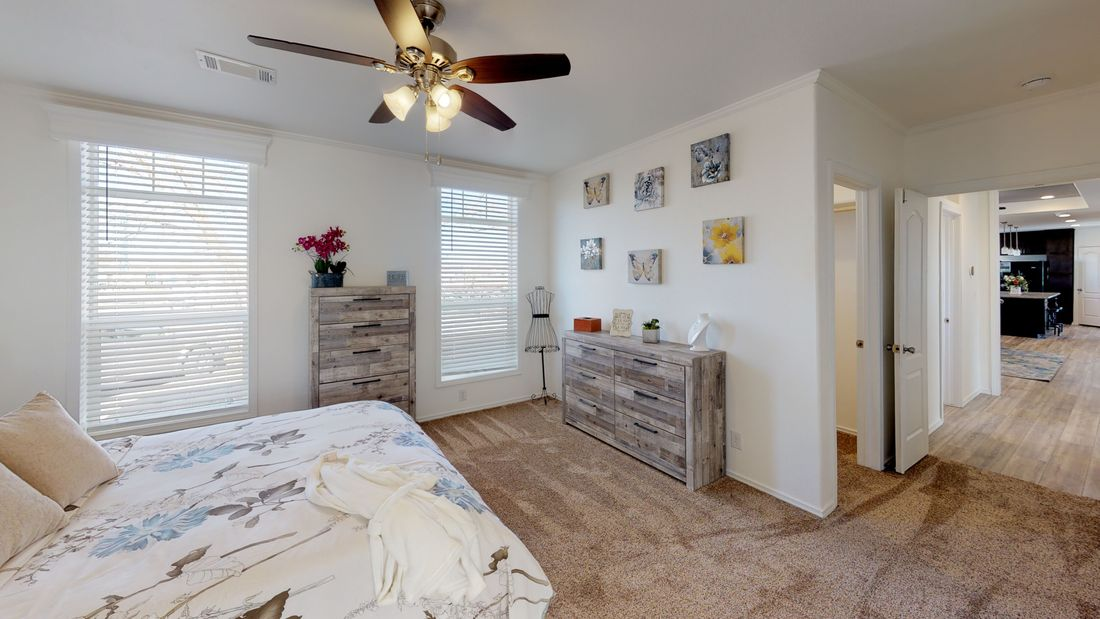 The SUM3068A Master Bedroom. This Manufactured Mobile Home features 3 bedrooms and 2 baths.