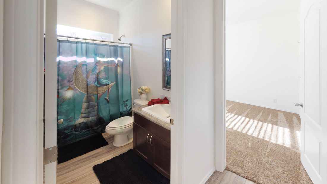 The SUM3068A Guest Bathroom. This Manufactured Mobile Home features 3 bedrooms and 2 baths.