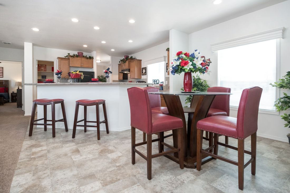The K2760A Dining Area. This Manufactured Mobile Home features 3 bedrooms and 2 baths.