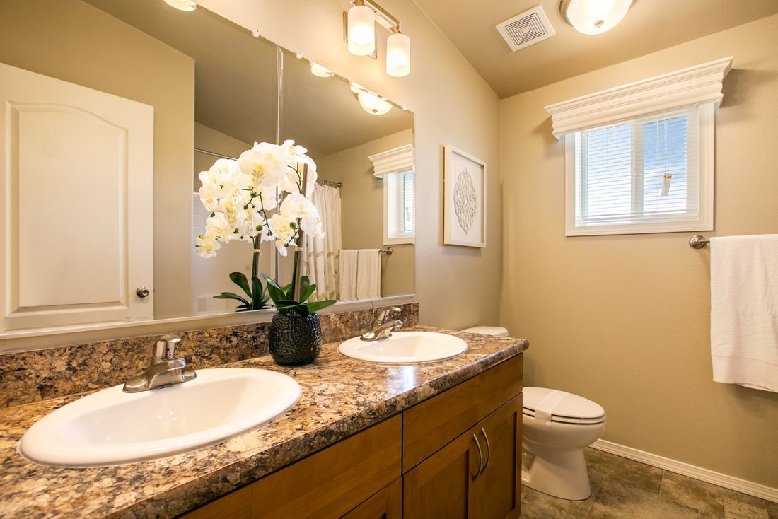 The THE WAVE Guest Bathroom. This Manufactured Mobile Home features 4 bedrooms and 2 baths.