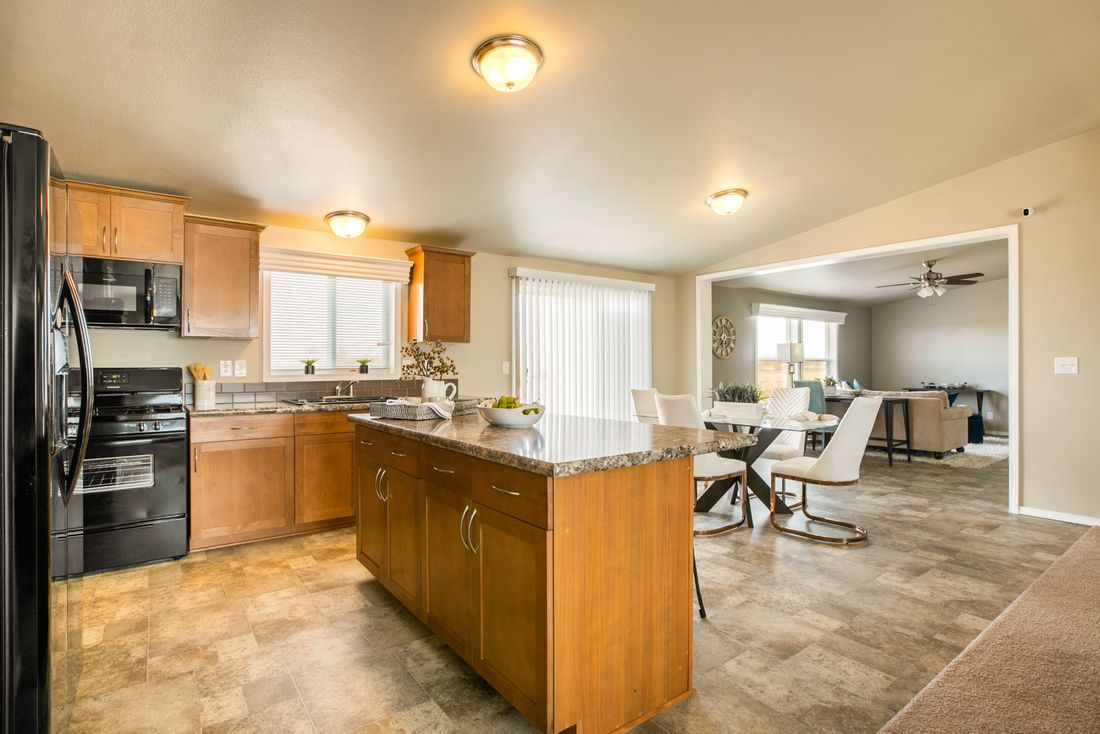 The THE WAVE Kitchen. This Manufactured Mobile Home features 4 bedrooms and 2 baths.