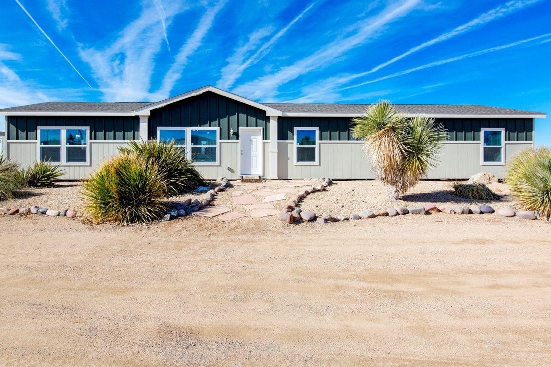 The THE WAVE Exterior. This Manufactured Mobile Home features 4 bedrooms and 2 baths.