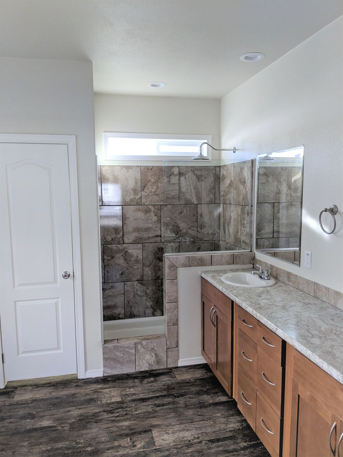 The THE ANNIVERSARY 3.0T Master Bathroom. This Manufactured Mobile Home features 3 bedrooms and 2 baths.