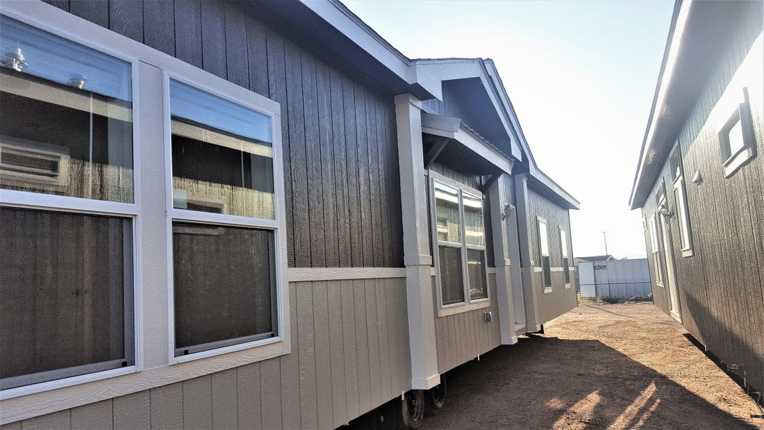 The THE ANNIVERSARY 3.0T Exterior. This Manufactured Mobile Home features 3 bedrooms and 2 baths.