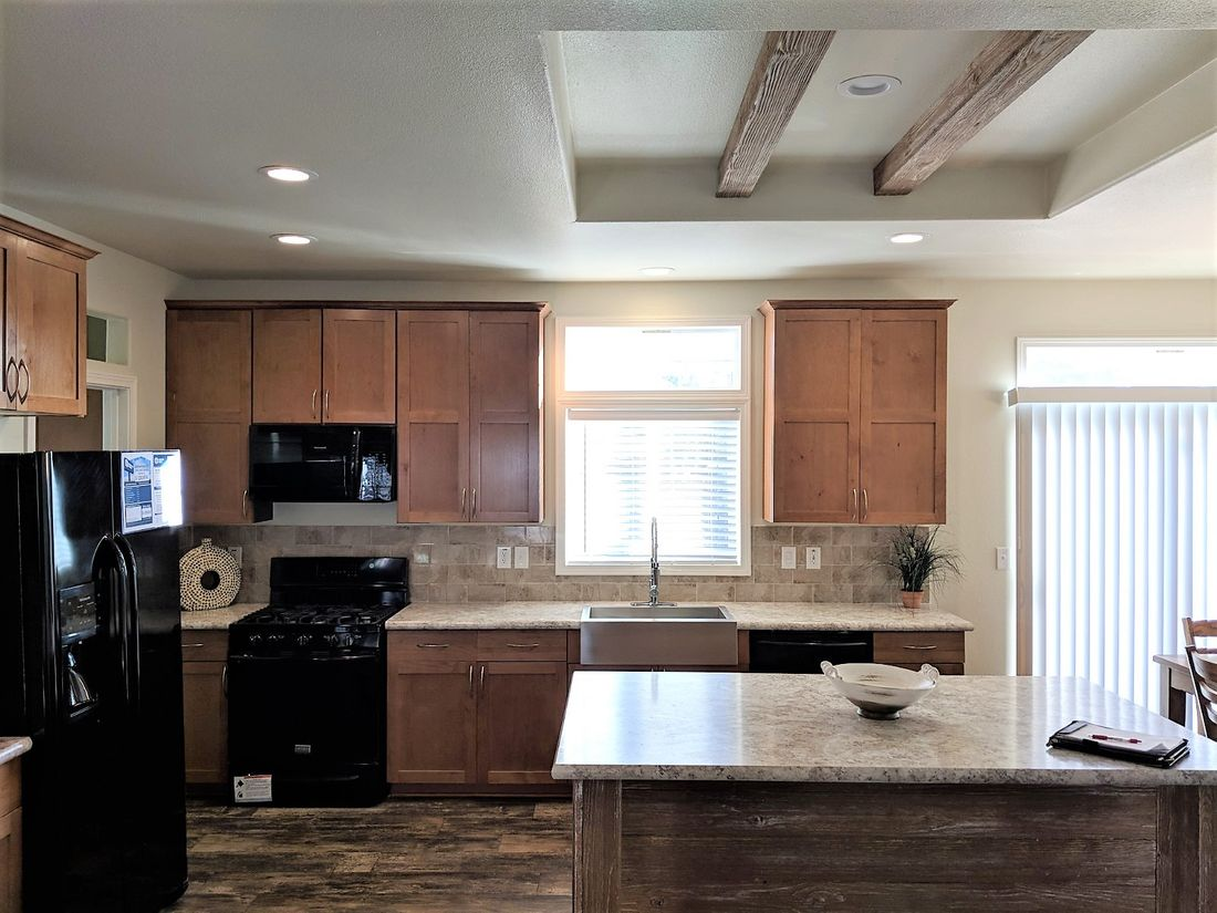 The THE ANNIVERSARY 3.0T Kitchen. This Manufactured Mobile Home features 3 bedrooms and 2 baths.