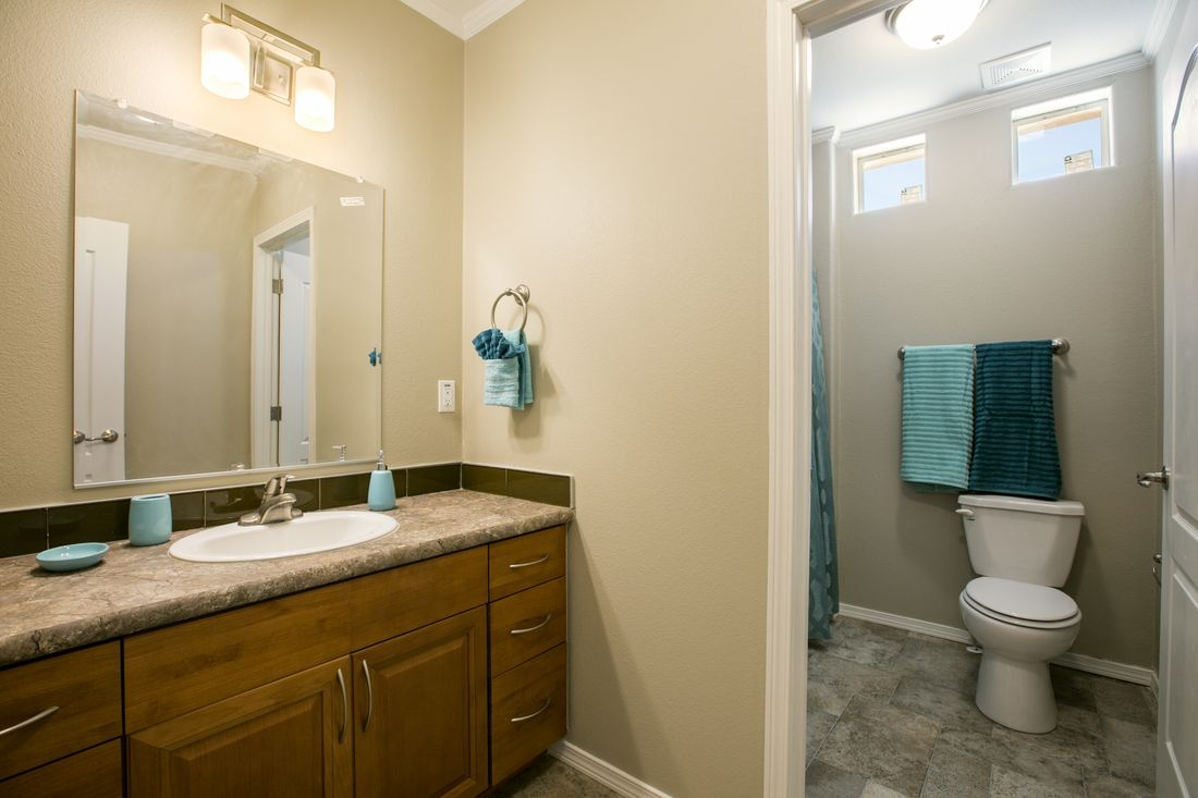 The TRANQUILITY TR3062A Guest Bathroom. This Manufactured Mobile Home features 3 bedrooms and 2 baths.