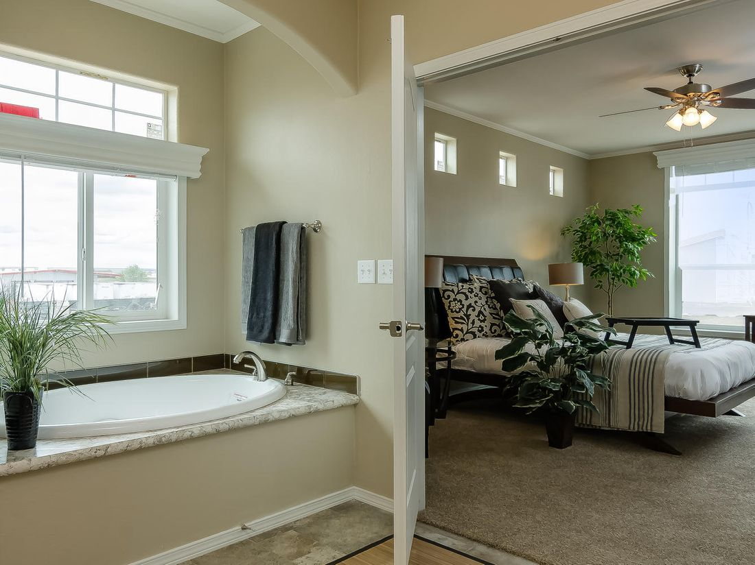 The TRANQUILITY TR3062A Master Bathroom. This Manufactured Mobile Home features 3 bedrooms and 2 baths.