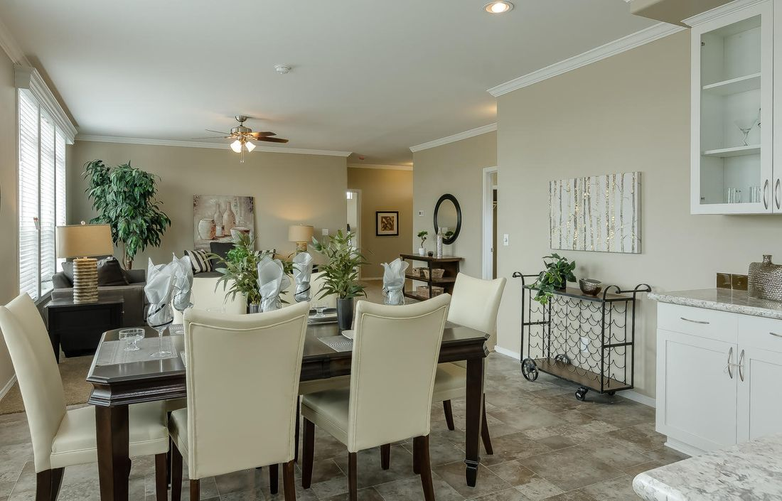 The TRANQUILITY TR3062A Dining Area. This Manufactured Mobile Home features 3 bedrooms and 2 baths.