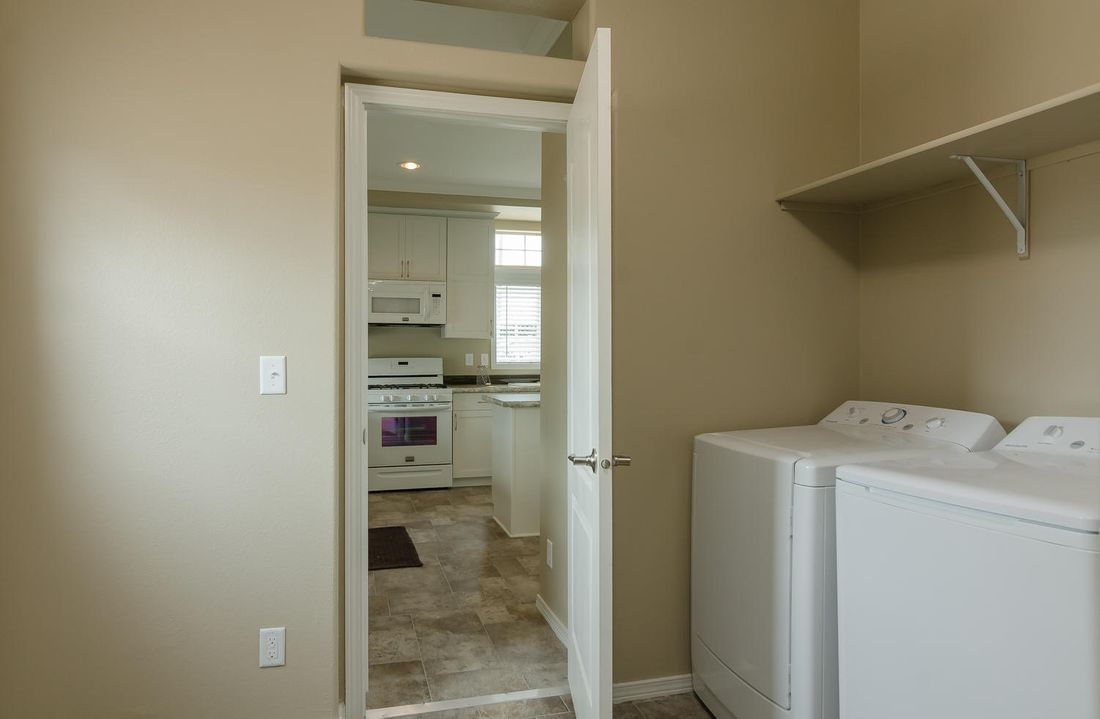 The TRANQUILITY TR3062A Utility Room. This Manufactured Mobile Home features 3 bedrooms and 2 baths.