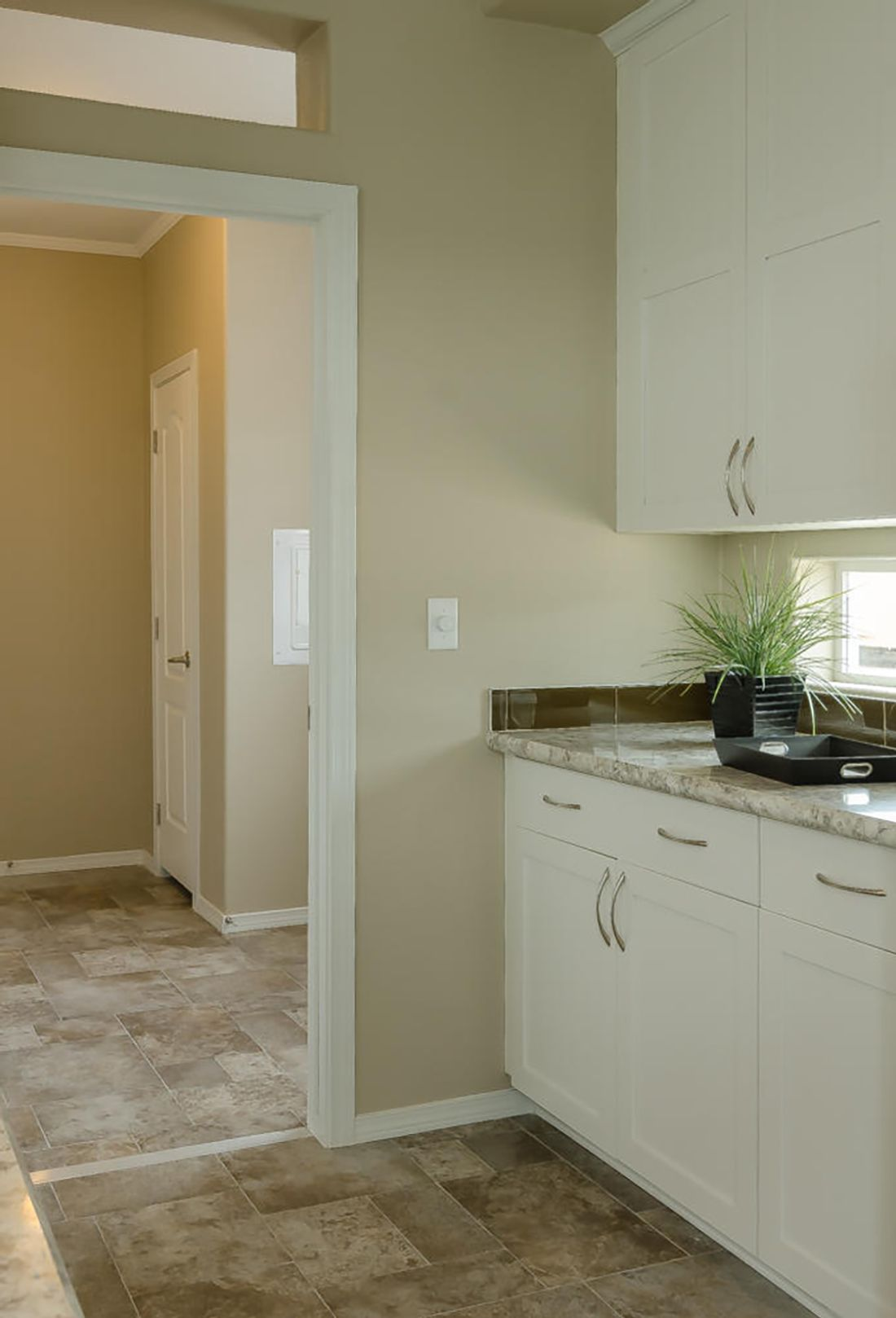 The TRANQUILITY TR3062A Kitchen. This Manufactured Mobile Home features 3 bedrooms and 2 baths.