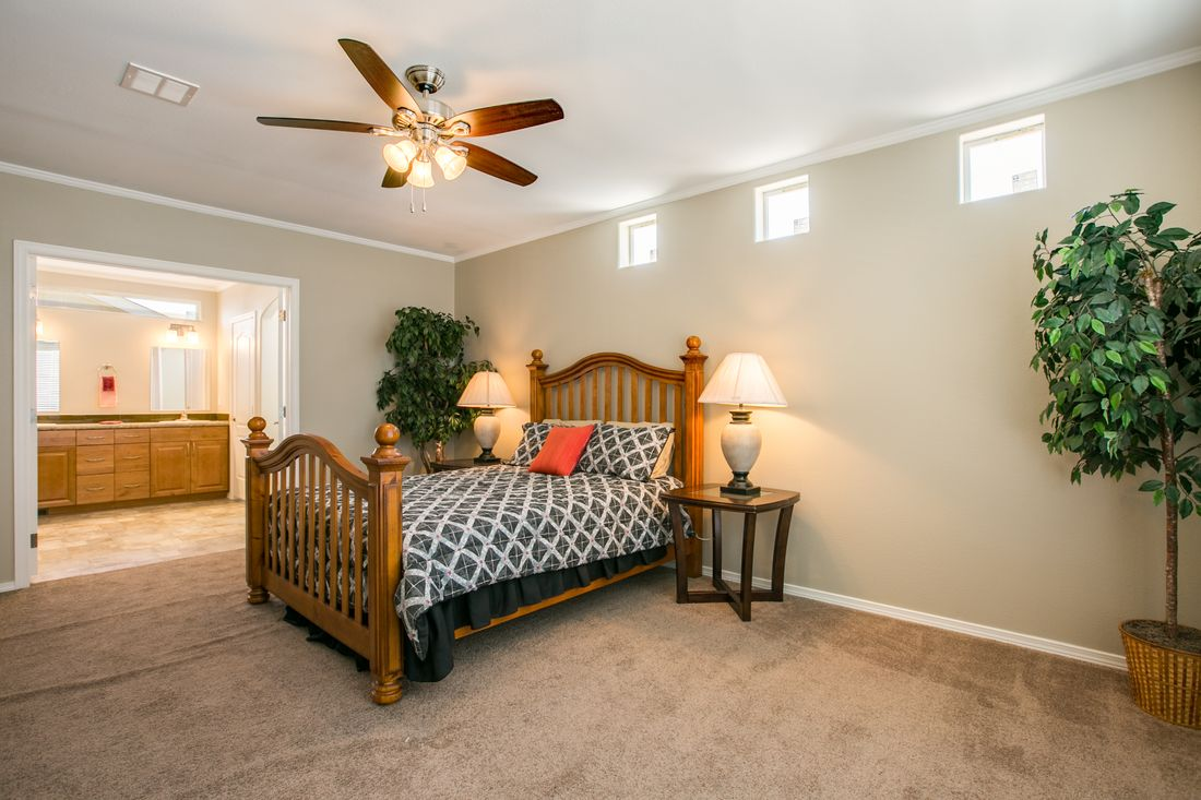 The TRANQUILITY TR3062A Master Bedroom. This Manufactured Mobile Home features 3 bedrooms and 2 baths.
