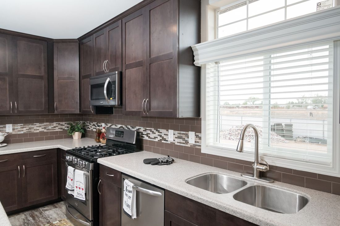 The ENCHANTMENT 3070A Kitchen. This Manufactured Mobile Home features 3 bedrooms and 2 baths.