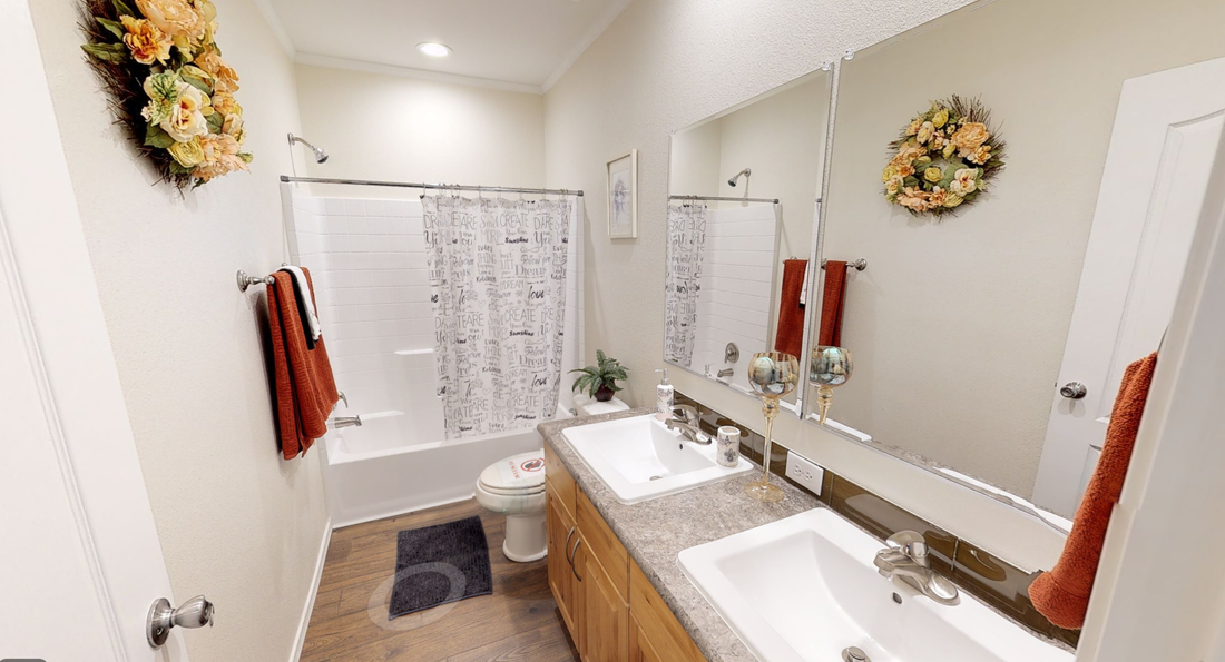 The K3066A Guest Bathroom. This Manufactured Mobile Home features 3 bedrooms and 2 baths.