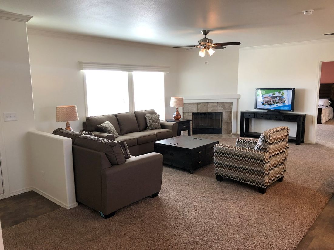 The K3066A Living Room. This Manufactured Mobile Home features 3 bedrooms and 2 baths.