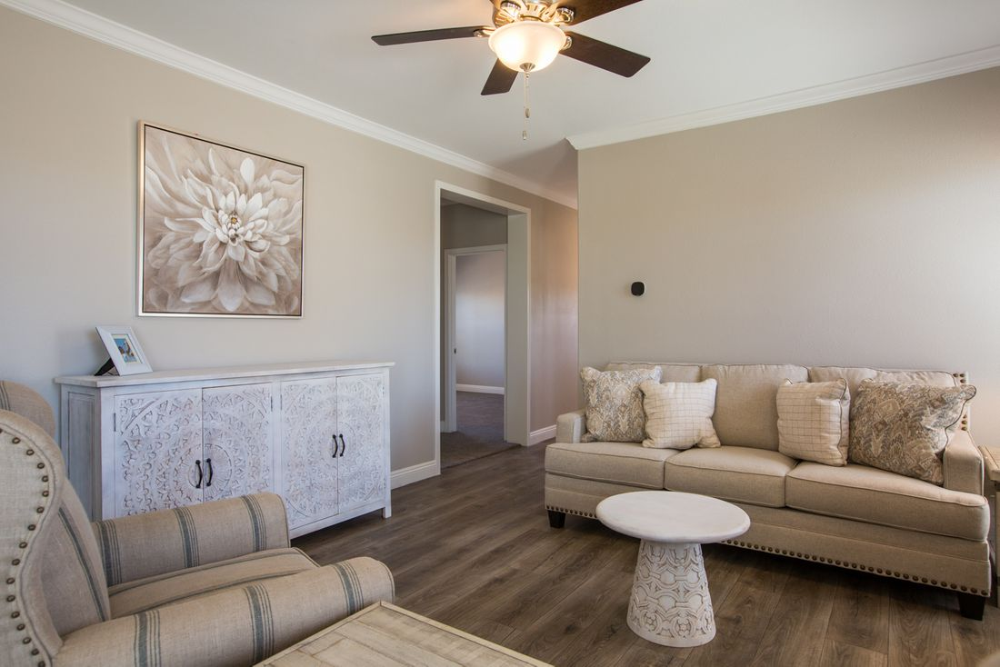 The EDGEWOOD Living Room. This Manufactured Mobile Home features 3 bedrooms and 2 baths.