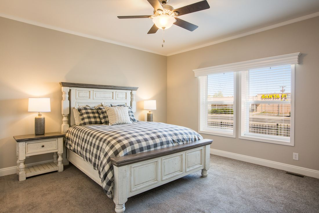 The EDGEWOOD Master Bedroom. This Manufactured Mobile Home features 3 bedrooms and 2 baths.