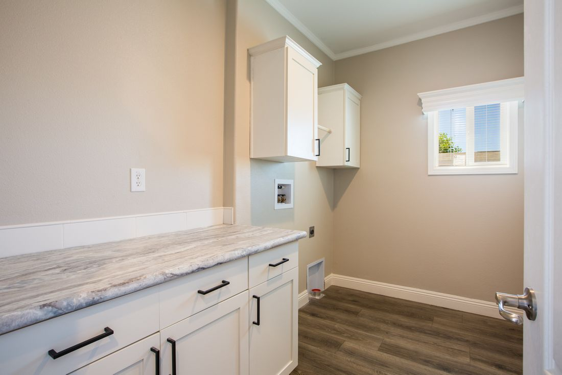 The EDGEWOOD Utility Room. This Manufactured Mobile Home features 3 bedrooms and 2 baths.