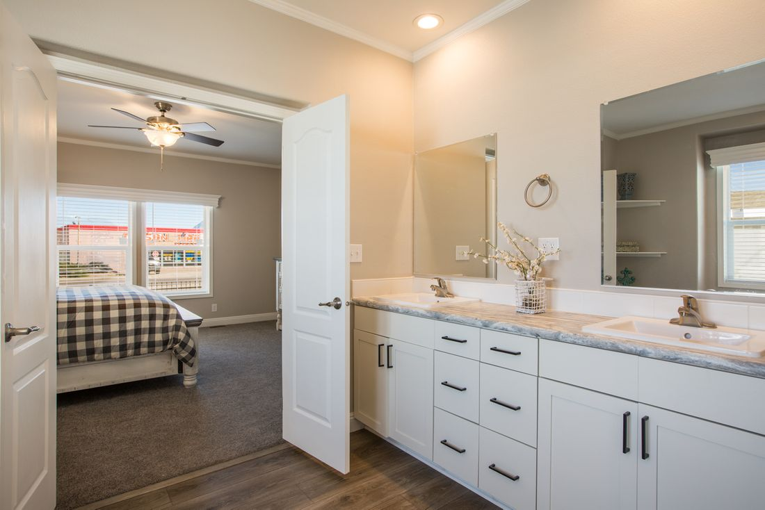 The EDGEWOOD Master Bathroom. This Manufactured Mobile Home features 3 bedrooms and 2 baths.