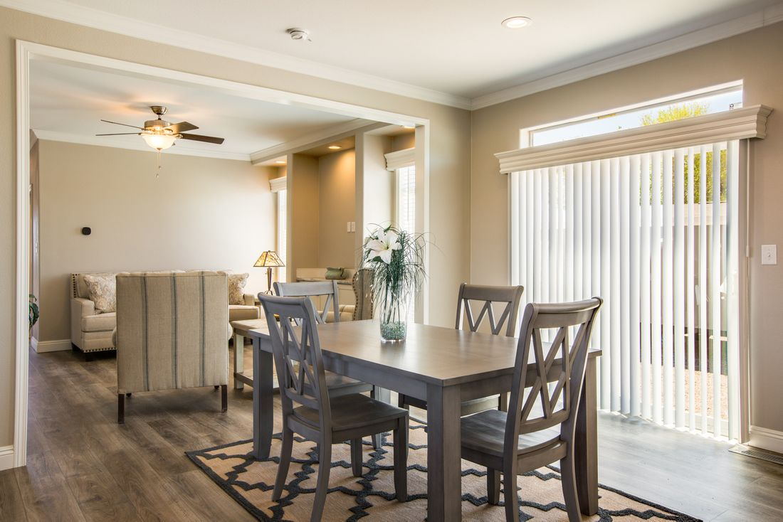 The EDGEWOOD Dining Area. This Manufactured Mobile Home features 3 bedrooms and 2 baths.